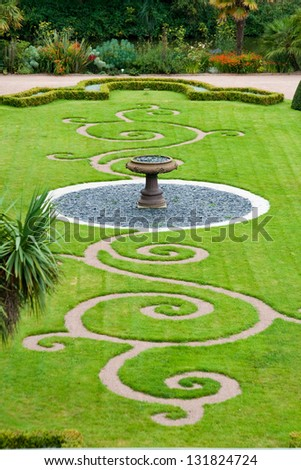 Garden in Castle des Ravalet (Chateau des Ravalet), Normandy, France - stock photo