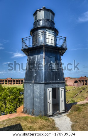 Garden Key Lighthouse at Fort Jefferson in Dry Tortugas National Park. - stock photo