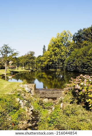 Garden lake in tranquil setting - Loire valley, France - stock photo