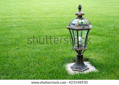 garden lamp on the grass lawn, - stock photo