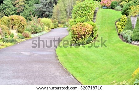 Garden landscape and walking path - stock photo