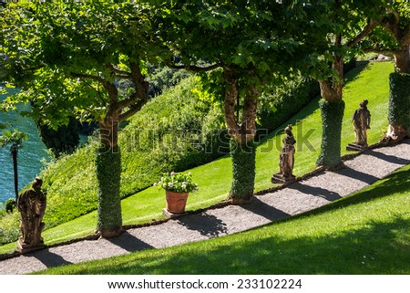 Garden landscaping in Lake Como area, Northern Italy. Landscaping, vacation, relax, spa, architecture, travel, tourism, living and lifestyle concept - stock photo