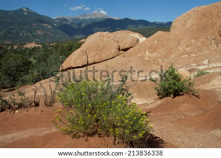 Garden of the Gods in Colorado Springs, Colorado - red rocks with Pikes Peak in background - stock photo