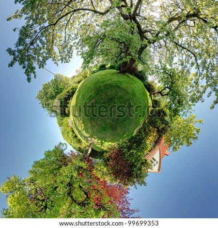 garden or park 360 panoramic image. lawn and trees with house in background. small planet rendering of home and gardens
