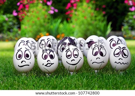 Garden party and many white eggs with funny faces