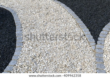 Garden paths of crushed stone and gravel
