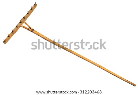Garden rake isolated on white.  Vintage Retro Wooden Rake Handmade   - stock photo