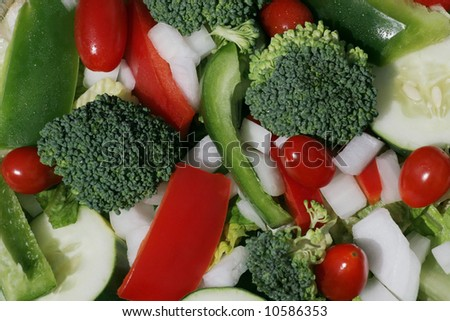 garden salad with broccoli,green and red peppers,onion, cucumber, tomatoes