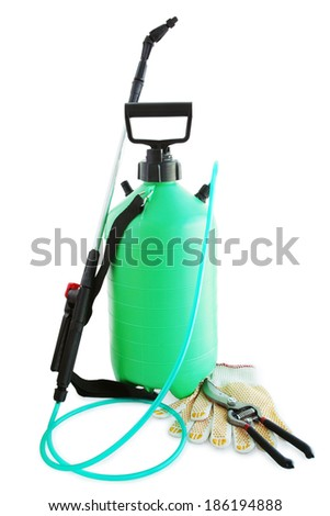 Garden sprayer to kill harmful insects, gloves and secateurs - stock photo