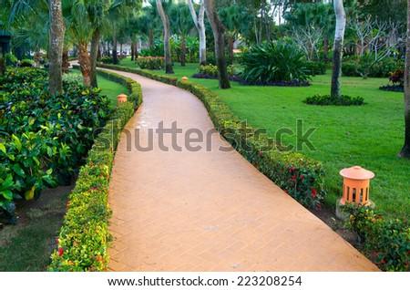 Garden stone path with grass - stock photo