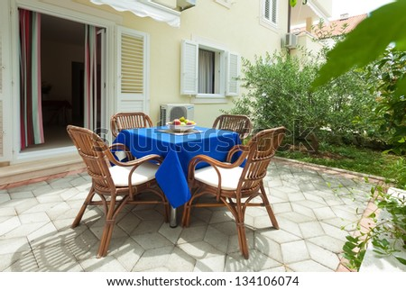 Garden terrace of apartment in mediterranean environment - stock photo