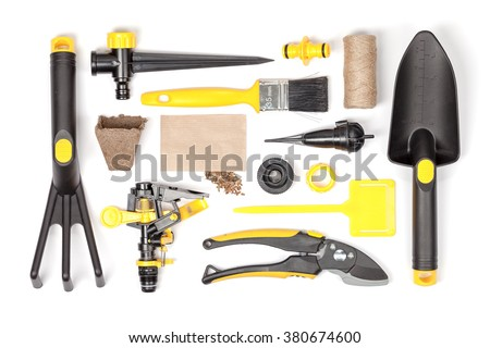 garden tools and essentials on white background top view. gardening flat lay concept