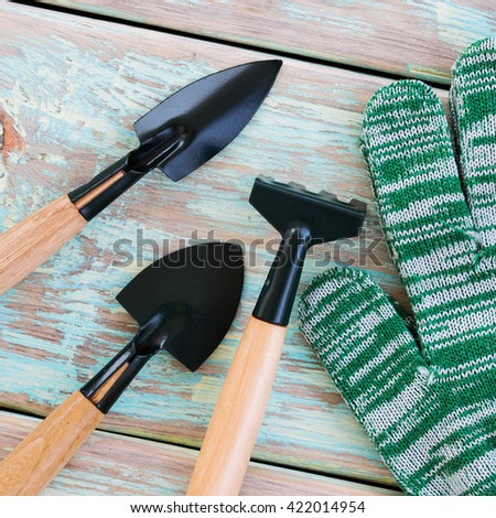 Garden tools - gloves, rakes and blades. Top view - stock photo
