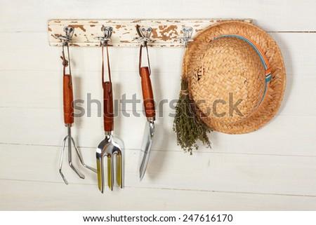 Garden tools hanging - stock photo