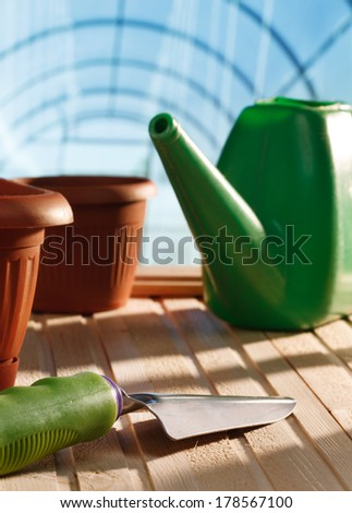 Garden tools in a greenhouse - stock photo