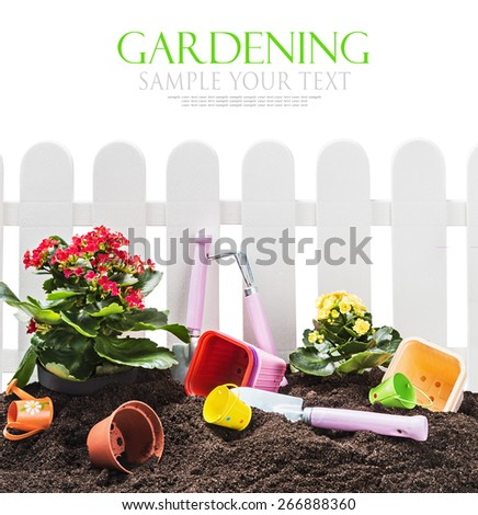 garden tools in soil isolated on white background. The text is an example and can be easily removed - stock photo