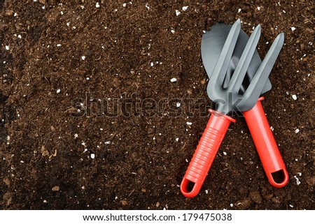 garden tools on a background of soil - stock photo