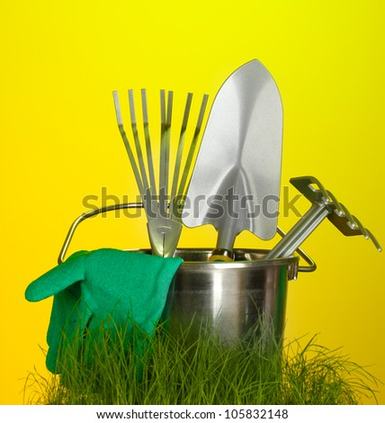 garden tools on grass on bright colorful background close-up