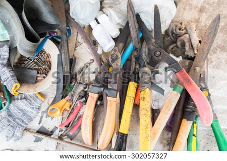 Garden tools on working table , it looked unordered and duty.