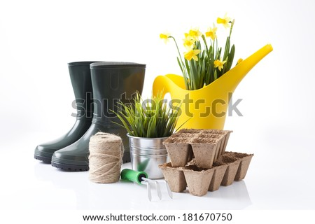 garden tools (shovel, rake, pruner, boots and peat pots ) over white  - stock photo