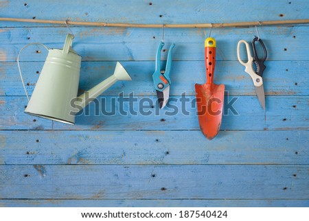 garden tools, watering can, scissor,shovel, free copy space - stock photo