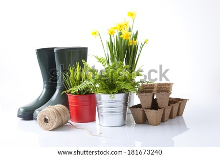 garden tools with flowerpots and boots - stock photo