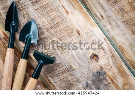 Garden tools with space for text - stock photo