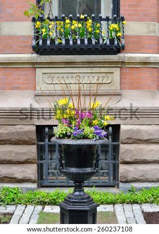 Garden urn, window box, metal grate - stock photo