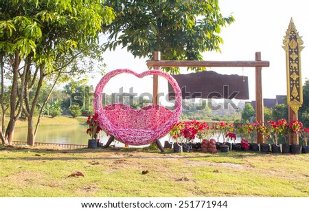 Garden with a heart chair - stock photo