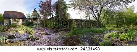 garden with blossomtree panorama