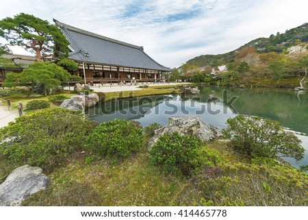 Garden with pond in front of Tenryu-ji Temple at Arashiyama, Kyoto, Japan - stock photo
