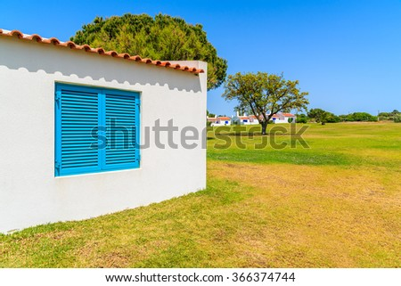 Garden with typical holiday house in Alvor town, Algarve region, Portugal - stock photo