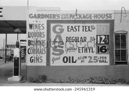 Gardener's Cut Rate Package House sign advertising alcoholic beverages and gasoline prices. Waco, Texas, Nov. 1939.