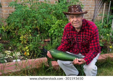 Gardener with a huge zucchini