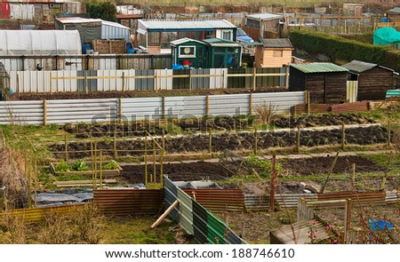 Gardeners allotment plots ready for cultivation of homegrown vegetables and flowers - stock photo