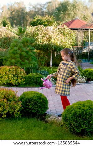 Gardening - adorable little girl working in garden