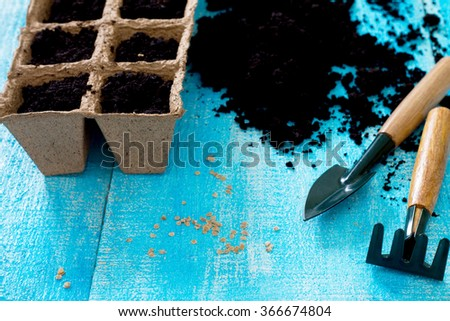 Gardening and landscaping - preparation for planting seeds, garden tools. - stock photo