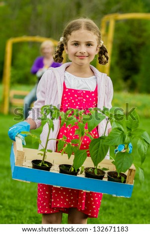Gardening, garden, planting concept - lovely gardener working with mother in the garden