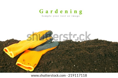 Gardening. Gloves on the earth, on a white background. - stock photo