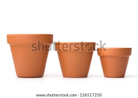 Gardening: group of empty ceramic flower pots, isolated on white background - stock photo