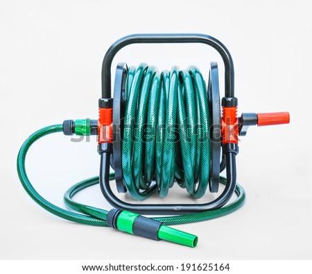 Gardening hose with nozzles isolated on white - stock photo