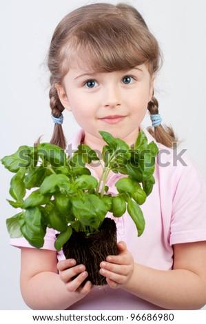 Gardening, lovely girl with seedling - stock photo