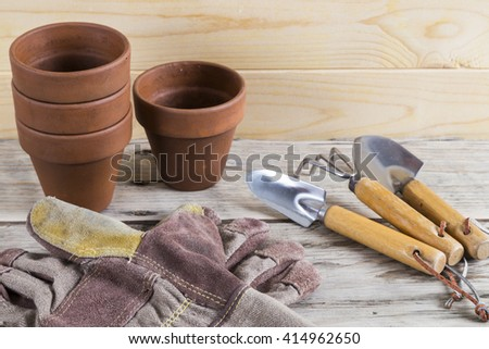 Gardening pots with tools and gloves - stock photo