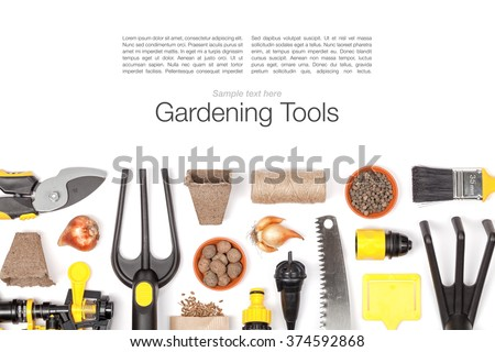 gardening tools and essentials on white background with copy space top view - stock photo