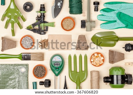 gardening tools and essentials on wooden background - stock photo