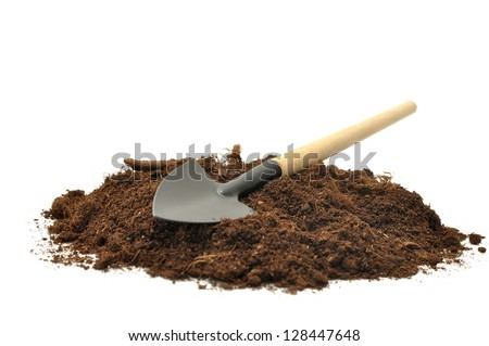 gardening tools and peat on a white background