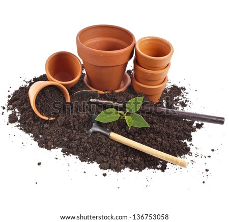 gardening tools and seedling in soil surface  isolated on a white background - stock photo
