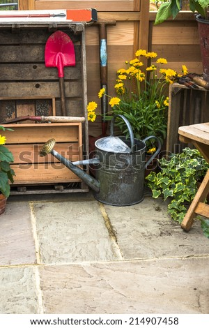Gardening tools in a shed - stock photo