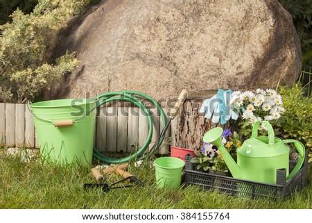 gardening tools in the garden - stock photo