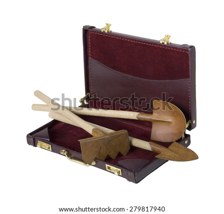 Gardening Tools including shovels and rake in a briefcase - path included - stock photo